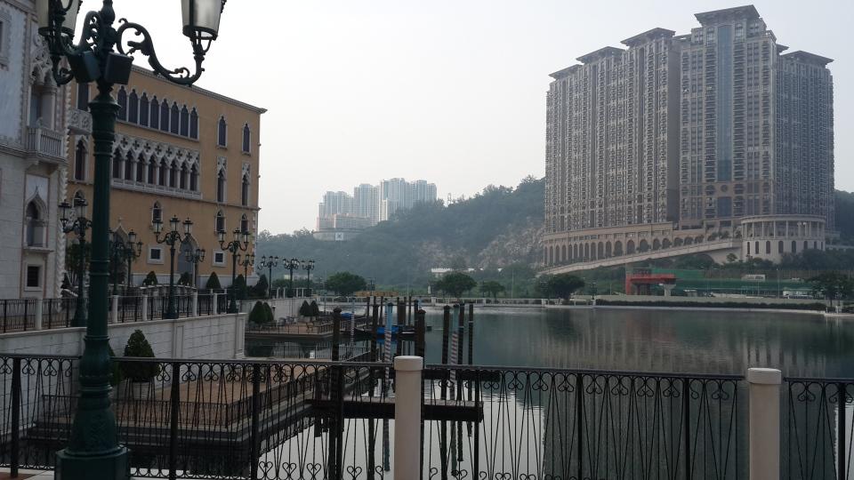 Macau Highrise overlooks Venetian cityscape.
