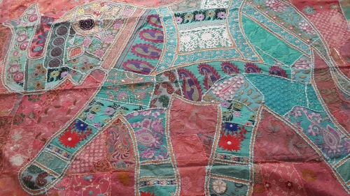 Exuberant patchwork, handloom fabrics, carvings and nature paintings