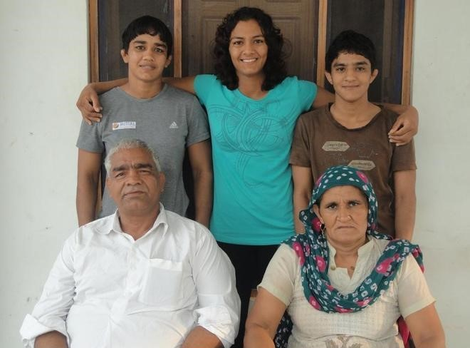 3 of the 6 girls with their parents. Image courtesy thebetterindia